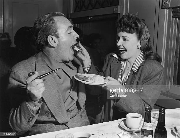 EXCLUSIVE American actor Frances Gifford feeds a forkful of pie a la mode to American actor Pat O'Brien while on tour with the Hollywood Victory...