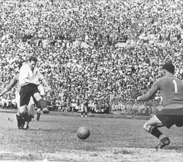 English footballer Tom Finney scoring England's fourth goal during a match against Italy at Turin.