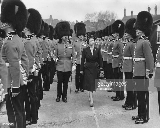 Princess Elizabeth inspects the troops of the 3rd Battalion Grenadier Guards of whom she is a colonel at Chelsea Barracks London