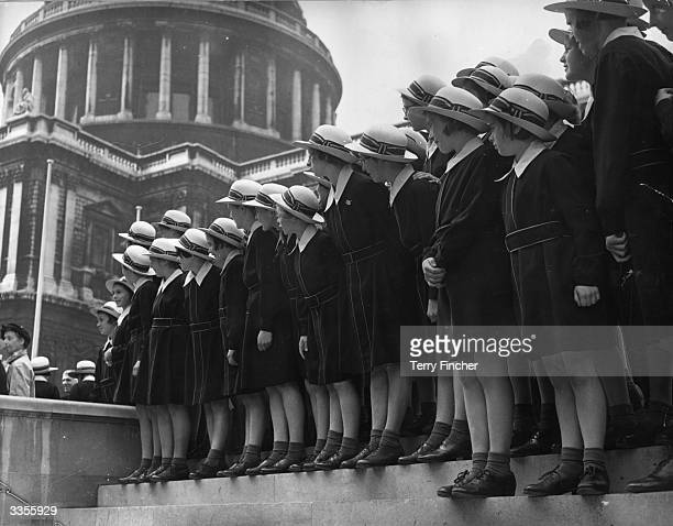 Schoolgirls from the Christ Hospital School, Hertfordshire, watch the boys from Christ Hospital School, Horsham, as they leave St Paul's Cathedral,...