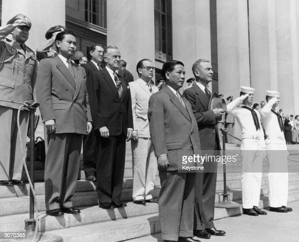 President Ngo Dinh Diem of Vietnam on left with Donald Quarles Deputy Secretary of Defence revewing a guard of honour outside the Pentagon in honour...