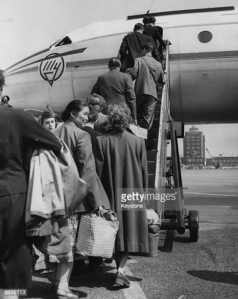 Passengers boarding a Moscow bound TU 104 jet passenger plane at London Airport at the opening of Aeroflot's new service to the Russian capital