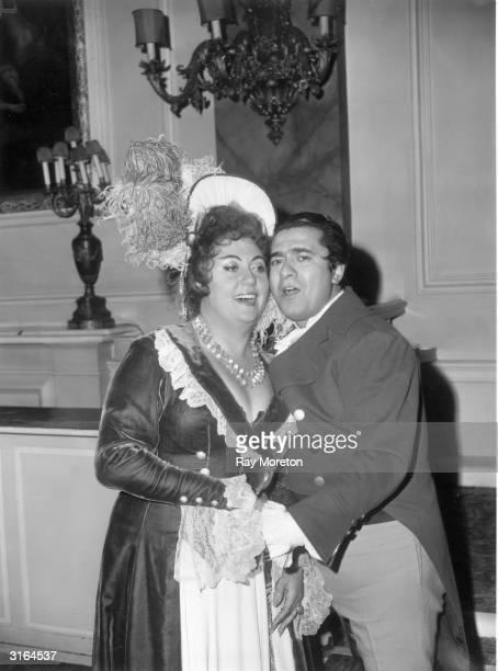 Italian tenor Giuseppe Di Stefano with French soprano Regine Crespin in costume for a dress rehearsal of Puccini's opera 'Tosca' at the Royal Opera...