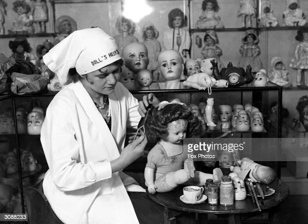 A doll being repaired and receiving a new hairstyle at a doll's hospital in a London department store