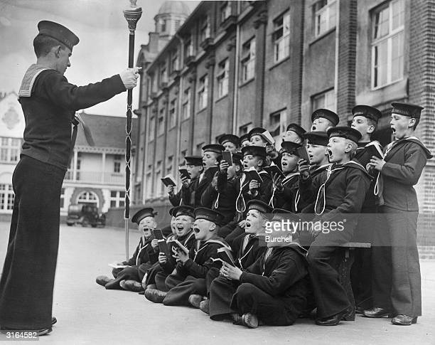The boys of the Royal Nautical School, at Portishead in Bristol, follow the conductor at rehearsals for the school's carol concert.