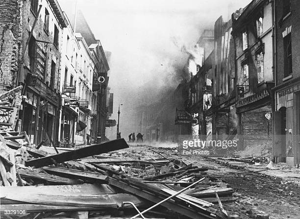 Gutted buildings and debris in Hertford Street Coventry after German bombing raids