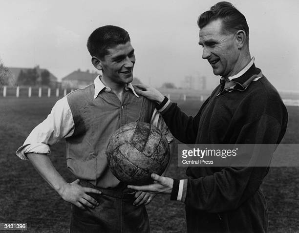 Peter Doherty the trainer of the Irish football team talking to Johnny Crossan who was banned for life by the Irish Football League but went on to...