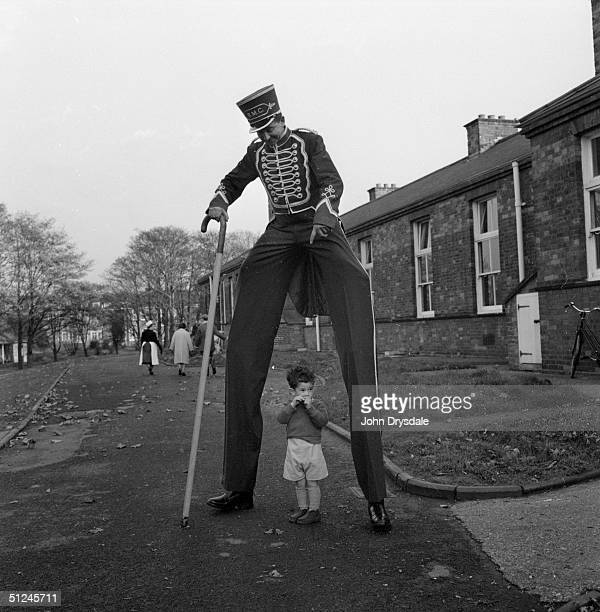 16th November 1962 Jeremy a young patient at Queen Mary Hospital Carshalton Surrey with Henry the stilt man during a visit to the hospital by...