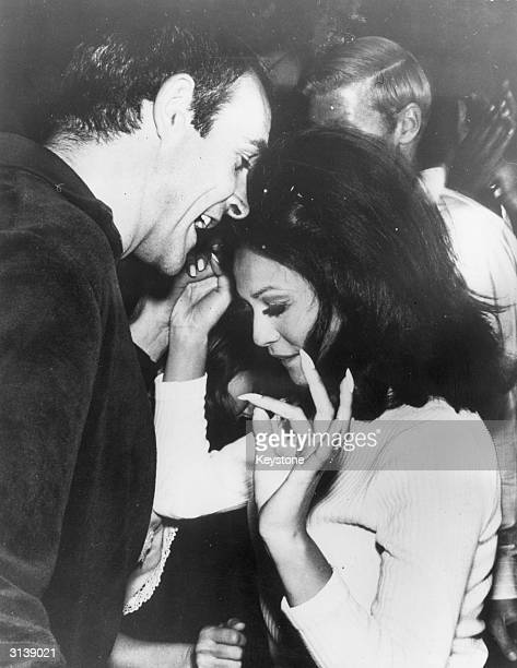 Film star Sean Connery dancing with actress Barbara Luna at a Hollywood party given in honour of the cast of the film 'King Rat'