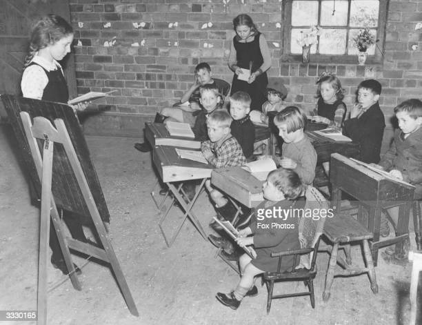 Sisters Mary and Frances Goodall teaching children at the school they established in the hamlet in which they live at Newsam Green, Yorkshire. The...
