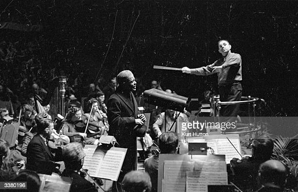 Hugo Weisgall conducting American tenor Roland Hayes and the London Symphony Orchestra at an Allied Forces concert organized by the Daily Express and...