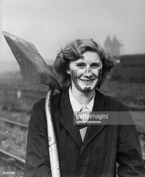 Betty Hall, a former waitress from Watford, who is working as part of a plate laying gang for British Rail at Willesden.