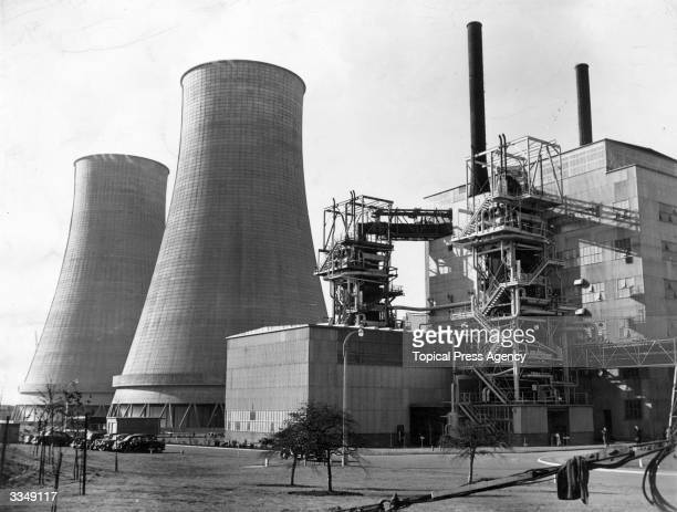 Cooling towers and reactor at the world's first fullscale atomic power station at Calder Hall Windscale Cumberland England The station which will use...