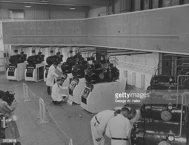Technicians testing precipitator units at the gas sampling plant Calder Hall Cumberland in preparation for the opening of the world's first atomic...