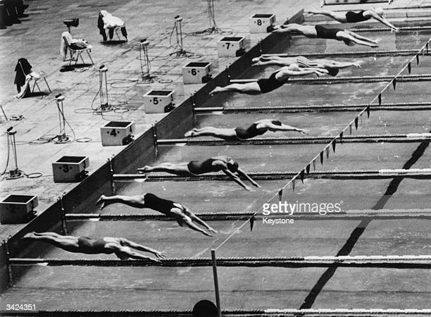The start of the 100 metre butterfly swimming race at the 1964 Tokyo Olympics Sharon Stouder of the USA was 1st Ada Kok of Holland was 2nd and...