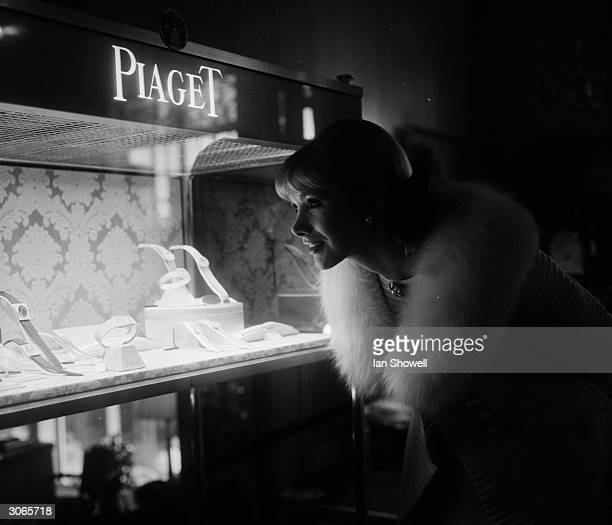 British actress Susan Hampshire examining the Piaget watch exhibition at Asprey's jewellers London