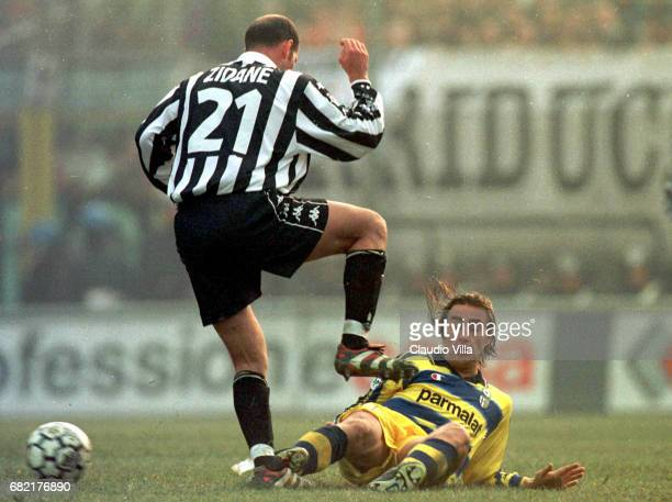 1 Zinedine Zidane of Juventus and Cannavaro of Parma compete for the ball