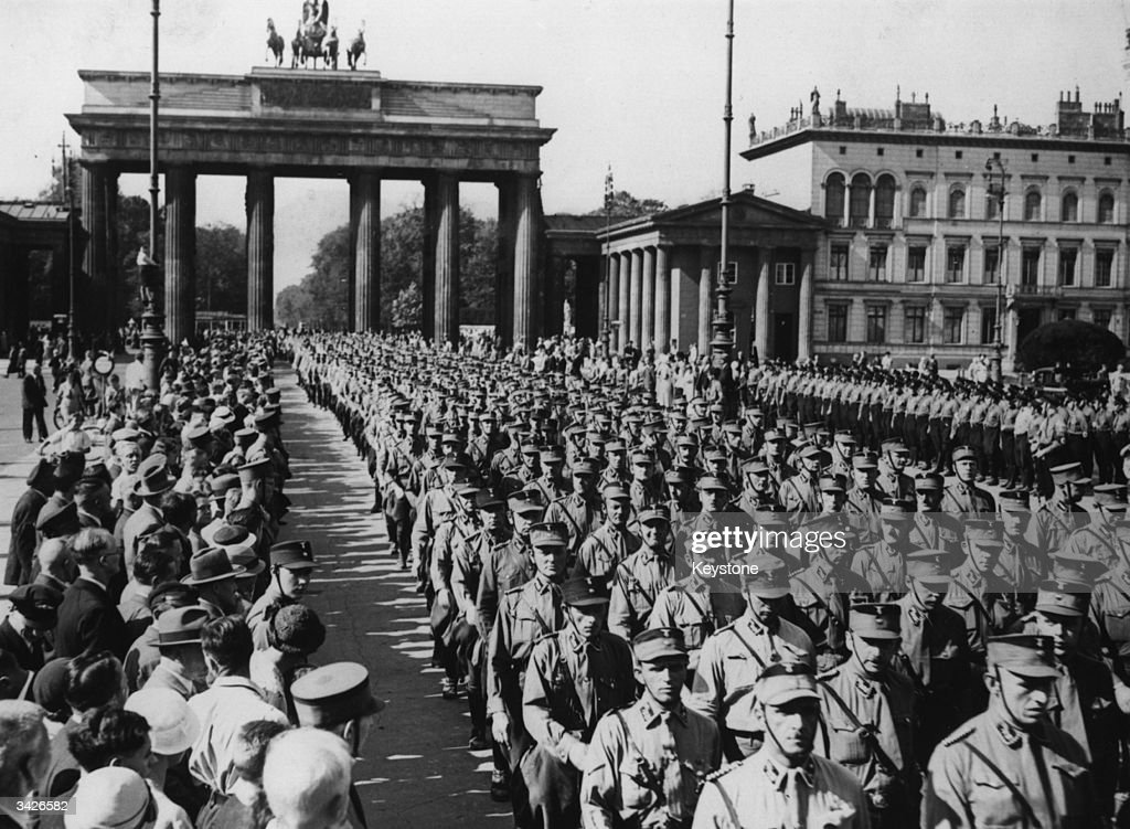 Berlin SA marching through the Brandenburg Gate in the Pariser Platz at a Nazi rally.