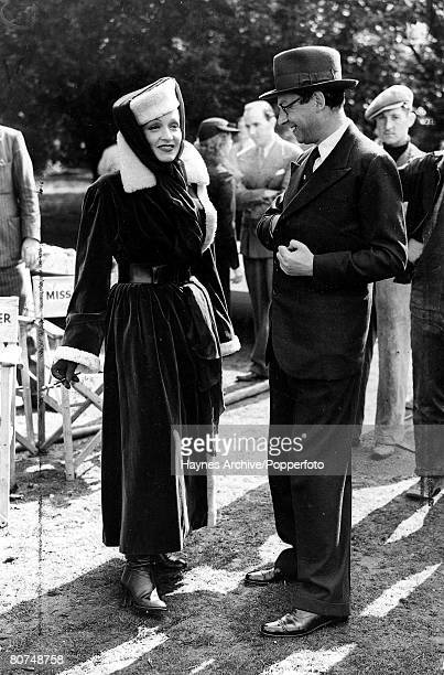16th September 1936 A picture of German born US actress and cabaret singer Marlene Dietrich with the director Alexander Korda on her first day of...