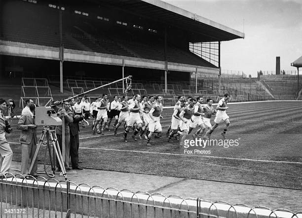 Members of the Arsenal football team training at Highbury before the BBC televised a match for the first time