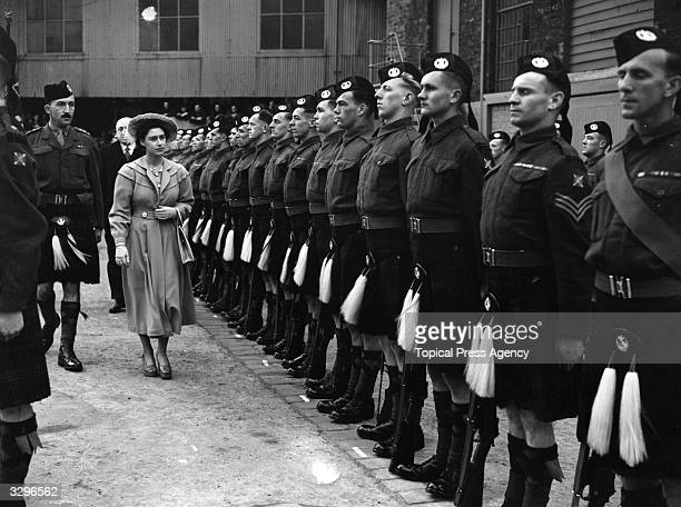 Princess Margaret Rose who was born in Scotland at Glamis Castle inspecting troops in Glasgow where she launched the tanker 'British Mariner'