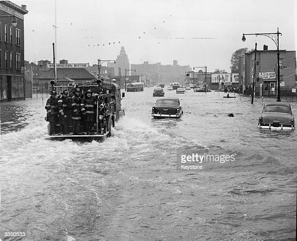 A fire tender being driven through a flooded street in New York street in the wake of Hurricane Donna in which 135 people lost their lives