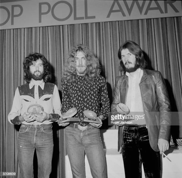British rock band Led Zeppelin collect their geode awards after being voted top British group in the Melody Maker Pop Poll in London From left to...