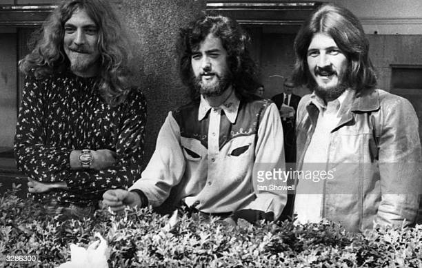 Three of the four members of British heavy rock group Led Zeppelin in Embankment Gardens London They pushed the Beatles down to number two taking the...