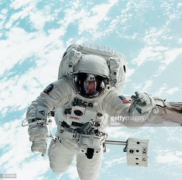 Mission specialist Michael L Gernhardt completes a spacewalk during the STS69 mission in the shuttle Endeavour