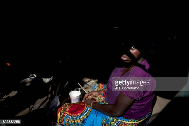 A 16yearol Mozambican girl who recently gave birth at Chipinge Hospital in Zimbabwe through surgical incision after fleeing unrest sits in her tent...