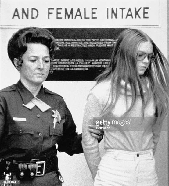 16yearold Brenda Spencer is led from court building where her arraignment on charges that she killed two men and wounded nine other persons in an...