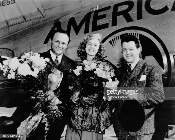 16yearold Doris Day is met by bandleader Barney Rapp and Joseph Cherniavsky musical director for WLW at the airport circa 1938 Day had just won a...