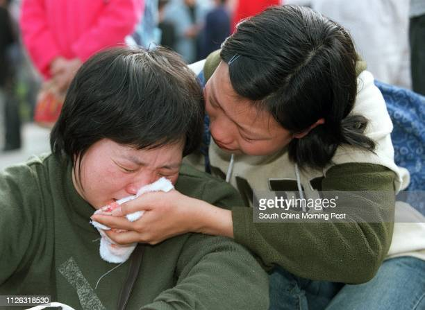 16yearold Fong Yuenmuk a failed abode seeker cries with mother Fong Lam Laumui during a rally at Victoria Park to fight for their rights to stay in...