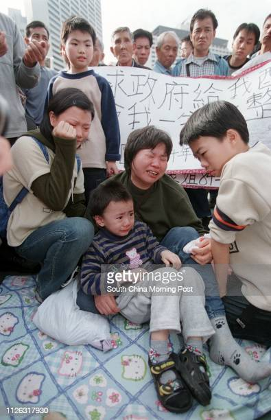 16yearold Fong Yuenmuk a failed right of abode seeker cries with mother Fong Lam Laumui and young brothers during a rally at Victoria Park to fight...