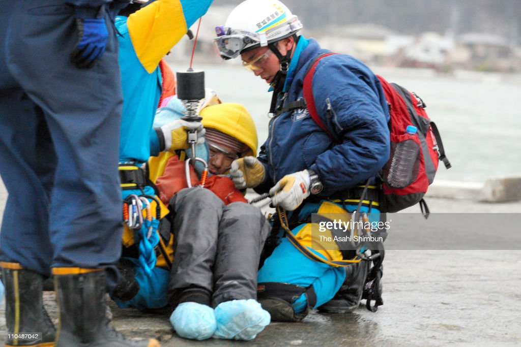 16-year-old Jin Abe is rescued from her destroyed house 9 days after the 9.0 magnitude earthquake and tsunami on March 20, 2011 in Ishinomaki, Miyagi, Japan. The quake struck offshore on March 11, 2:46pm local time, triggering a tsunami wave of up to 10 metres which engulfed large parts of north-eastern Japan. The death toll continues to rise with fears that the official death count could well reach up to 10,000 in 'the most tragic event in Japanese history since World War Two'.