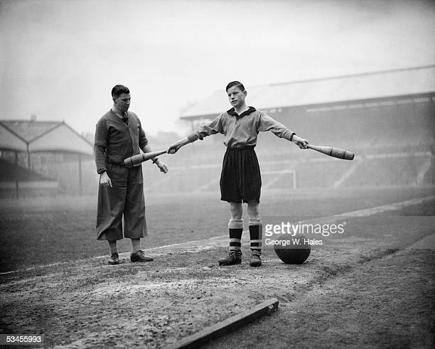 16yearold Kevin Doherty works out with a pair of Indian clubs under the watchful eye of Wolverhampton trainer Jack Davies 23rd February 1938 Kevin...