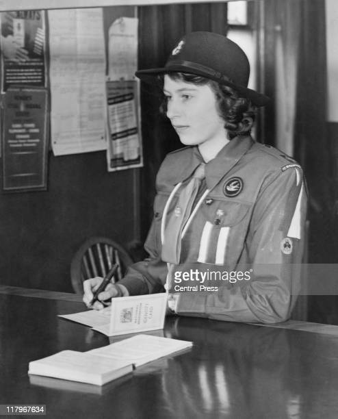A 16yearold Princess Elizabeth registers for war service under the Ministry of Labour's Youth Registration Scheme 25th April 1942 She is wearing her...