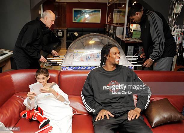 16yearold Stephen Kmet chilled out with Chris Bosh in Marnie's Lounge at Toronto's Sick Kids Hospital Tuesday afternoon while Raptor Coach Jay Triano...