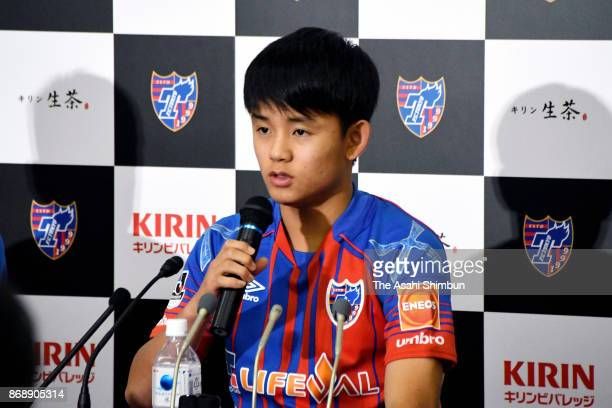 16yearold Takefusa Kubo of FC Tokyo speaks during a press conference as the club announced to promote him to the top team at the FC Tokyo Kodaira...