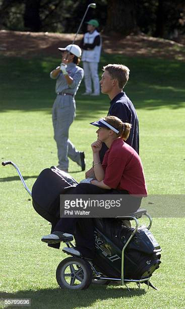 16yr old Chanelle Baird from Whangaparoa with her caddy Brian Henry watch Jane Park from Titirangi play her shot in the Championship Final of the...