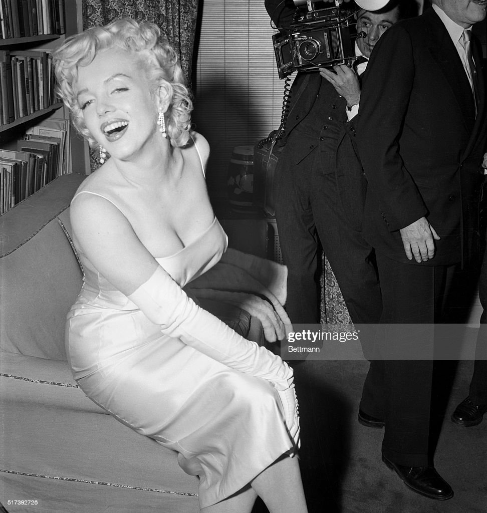 New York, NY- Marilyn Monroe poses for the photographer at a cocktail party thrown by attorney Frank Delaney.