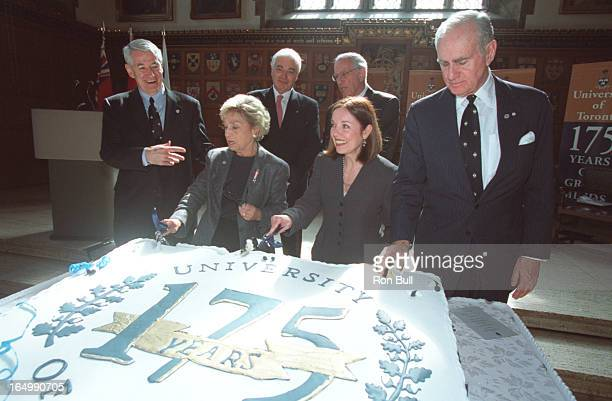175th birthday UofT Cutting the cake dignitaries l to r Robert Birgeneau president of T of T , foreground women Dr Rose Wolfe chair of the 175...