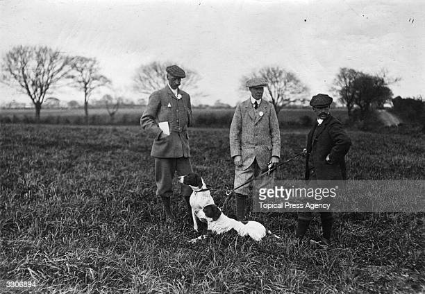 From left to right C Brewster Macpherson Lieutenant Col Owens and H L Williams at the Kennel Club Field Trial at Orwell Park