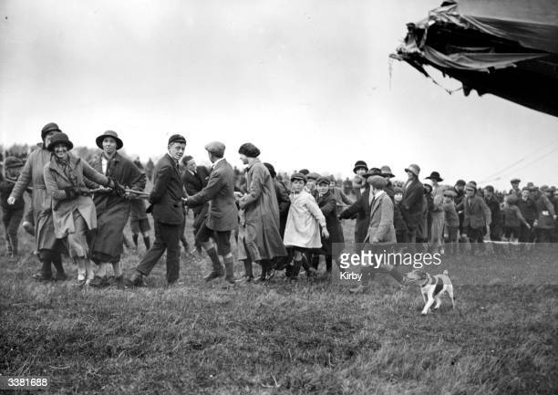 Enthusiastic volunteers dragging the damaged R33 airship back to Pulham Norfolk after 28 hours alloft