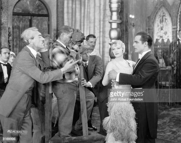 RussianSwedish film director Mauritz Stiller directing the Swedish born American actress Greta Garbo and Antonio Moreno in 'The Temptress' before MGM...