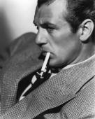 17th april 1934 american actor gary cooper smoking a cigarette picture id3170076?s=170x170