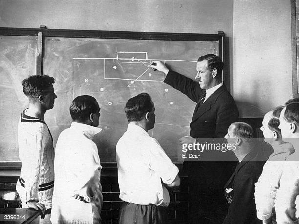 Football referee S F Evans describing the offside rule with the aid of a blackboard to public schoolmasters at Mill Hill School London