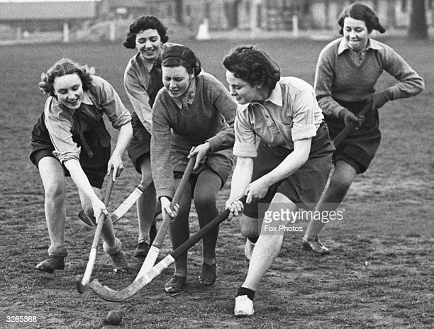 A happy group of ATS girls play a game of hockey
