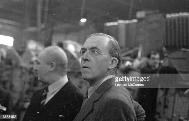 English Labour statesman and Minister of Aircraft Production Sir Richard Stafford Cripps during a visit to a British aircraft factory Original...