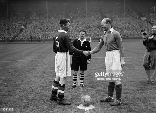 The captains of Chelsea and Charlton Athletic shake hands before the start of their South League Cup Final match at Wembley Stadium which Charlton...